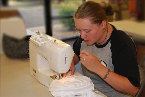 student shown sewing
